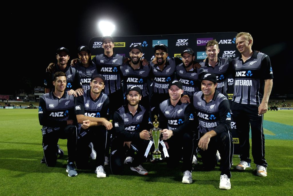 Hamilton: New Zealand players celebrate with the trophy after winning the third T20I match against India at Seddon Park in Hamilton, New Zealand on Feb 10, 2019. (Photo: Surjeet Yadav/IANS) - Surjeet Yadav