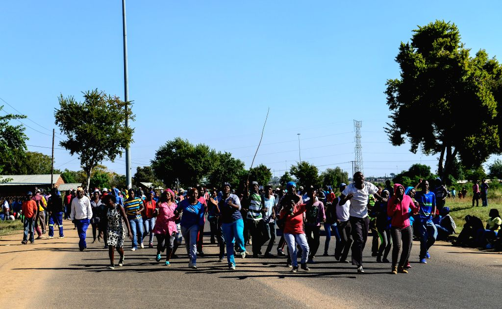 HAMMANSKRAAL, May 24, 2016 - Protestors gather outside of the municipal offices of Themba in Hammanskraal, north of Pretoria, South Africa, on May 24, 2016. At least two people have been killed and ...