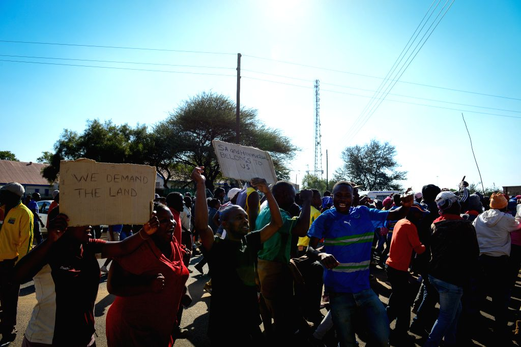 HAMMANSKRAAL, May 24, 2016 - Protestors shout slogans outside of the municipal offices of Themba in Hammanskraal, north of Pretoria, South Africa, on May 24, 2016. At least two people have been ...