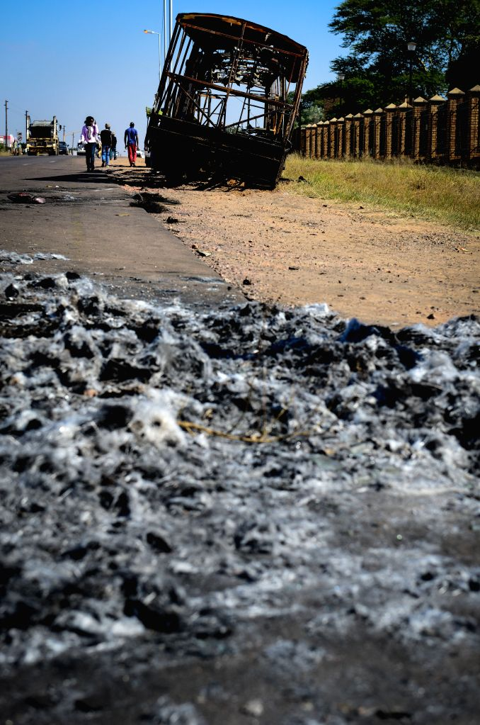 HAMMANSKRAAL, May 24, 2016 - The wreck of a burnt bus is seen in Hammanskraal, north of Pretoria, South Africa, on May 24, 2016. At least two people have been killed and six others injured during a ...