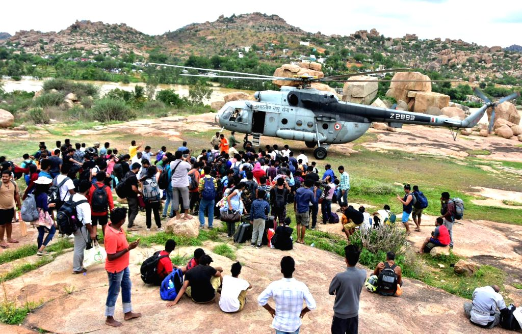 Hampi: As many as 365 tourists, including 100 from overseas, were rescued from the world famous Hampi heritage site in Karnataka, as heavy rains and flash floods stranded them over the last 2-3 days on Aug 13, 2019. The Indian Air Force (IAF) crew ai