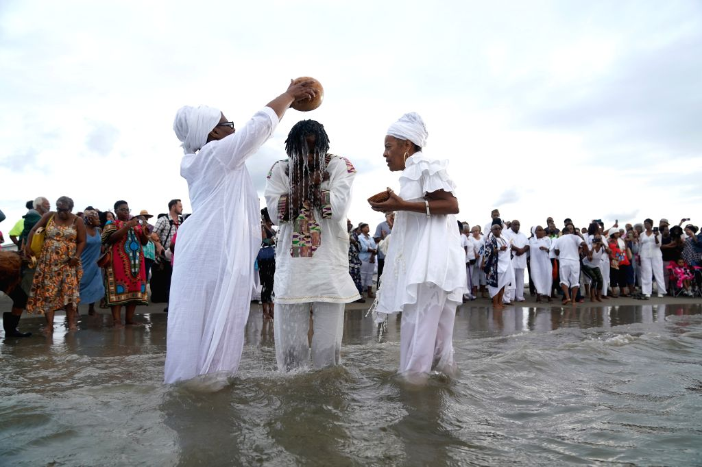 HAMPTON (U.S.), Aug. 24, 2019 People attend a cleansing ceremony at Buckroe Beach in Hampton, Virginia, on Aug. 24, 2019. Activities are held from Aug. 23 to 25 in commemoration of the ...