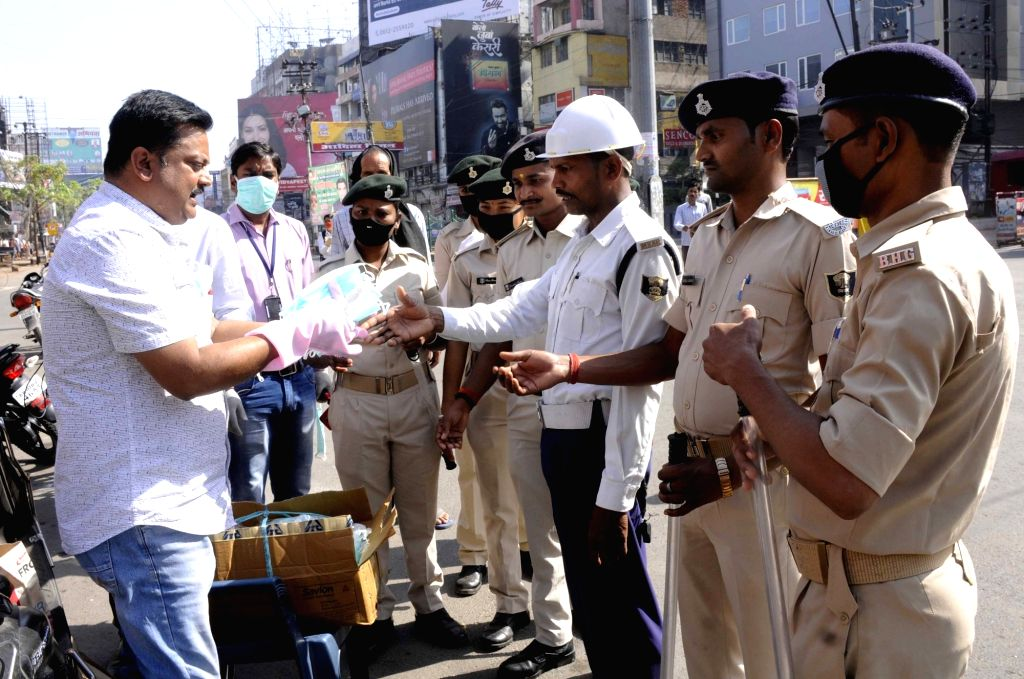 Hand gloves, sanitisers and masks being distributed among police personnel on Day 2 of the 21-day nationwide lockdown imposed by the Narendra Modi government over the coronavirus pandemic; in ... - Narendra Modi