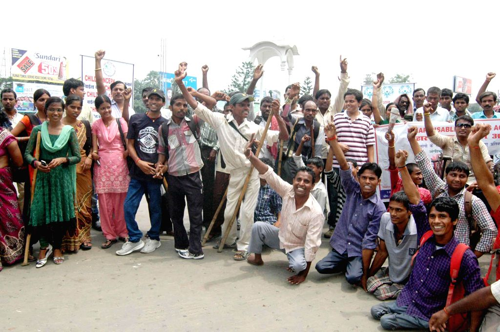 Handicapped people stage a demonstration to press for their demands in Patna on Aug 25, 2014.