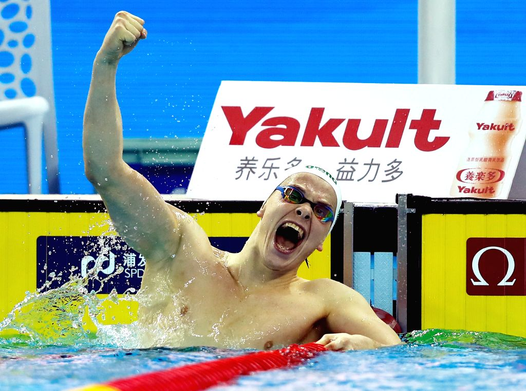 HANGZHOU, Dec. 11, 2018 - Danas Rapsys of Lithuania celebrates after winning Men's 400m Freestyle Final at 14th FINA World Swimming Championships (25m) in Hangzhou, east China's Zhejiang Province, on ...