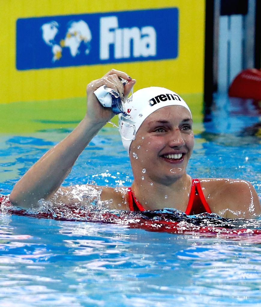 HANGZHOU, Dec. 12, 2018 - Katinka Hosszu of Hungary celebrates after Women's 200m Butterfly Final at 14th FINA World Swimming Championships (25m) in Hangzhou, east China's Zhejiang Province, on Dec. ...