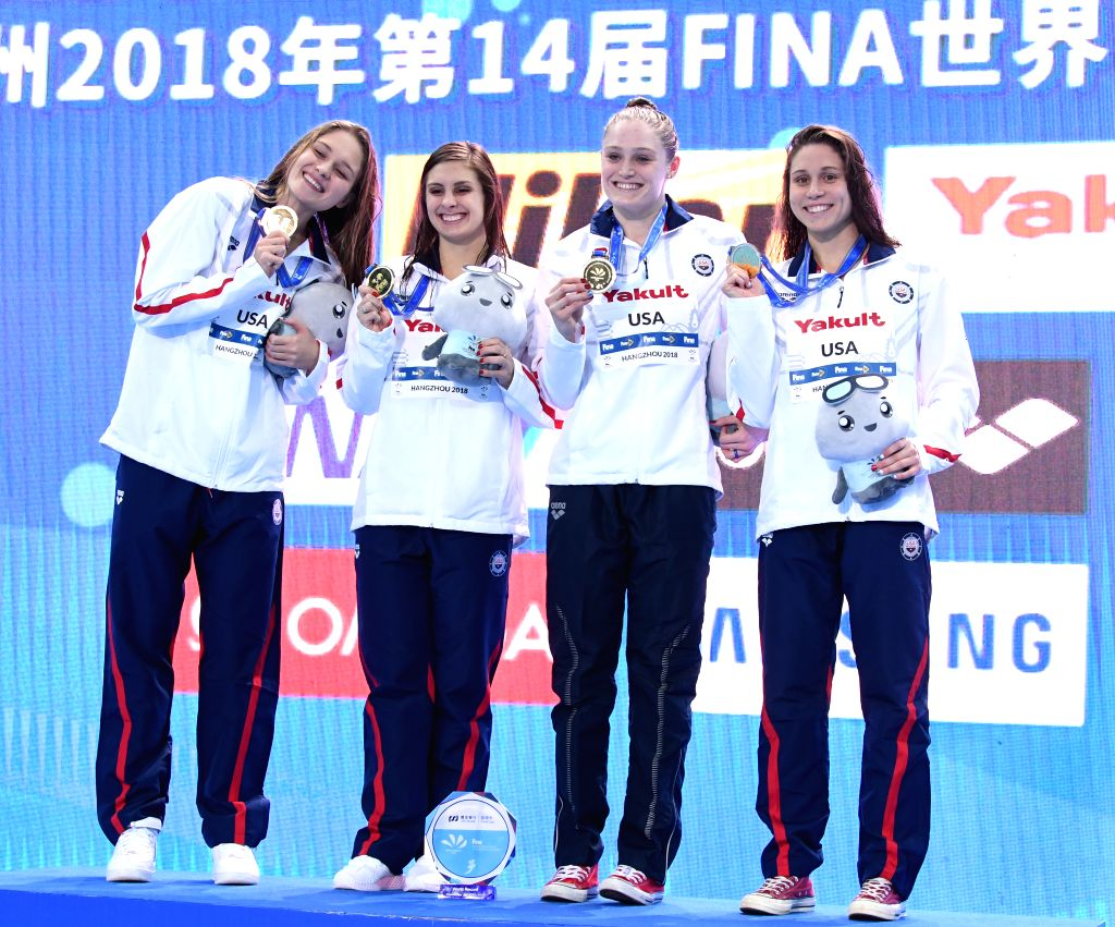 HANGZHOU, Dec. 12, 2018 - Members of the United States pose for photo during the awarding ceremony of the Women's 4X50m Medley Relay Final at 14th FINA World Swimming Championships (25m) in Hangzhou, ...