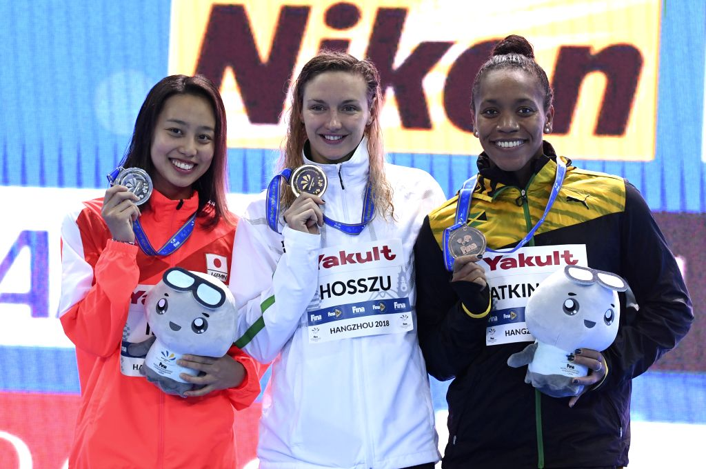 HANGZHOU, Dec. 14, 2018 - Gold medalist Katinka Hosszu (C) of Hungary, silver medalist Imai Runa (L) of Japan and bronze medalist Alia Atkinson of Jamaica pose for photo during the awarding ceremoy ...