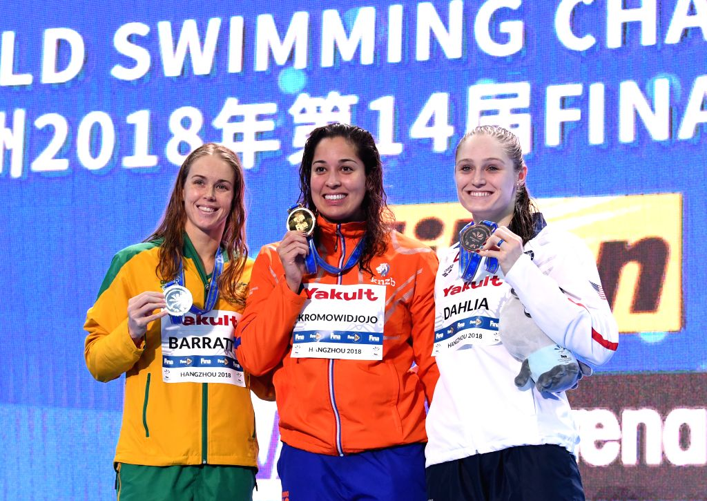 HANGZHOU, Dec. 14, 2018 - Gold medalist Ranomi Kromowidjojo (C) of the Netherlands, silver medalist Holly Barratt of Australia and Bronze medalist Kelsi Dahlia of the United States pose for photo ...