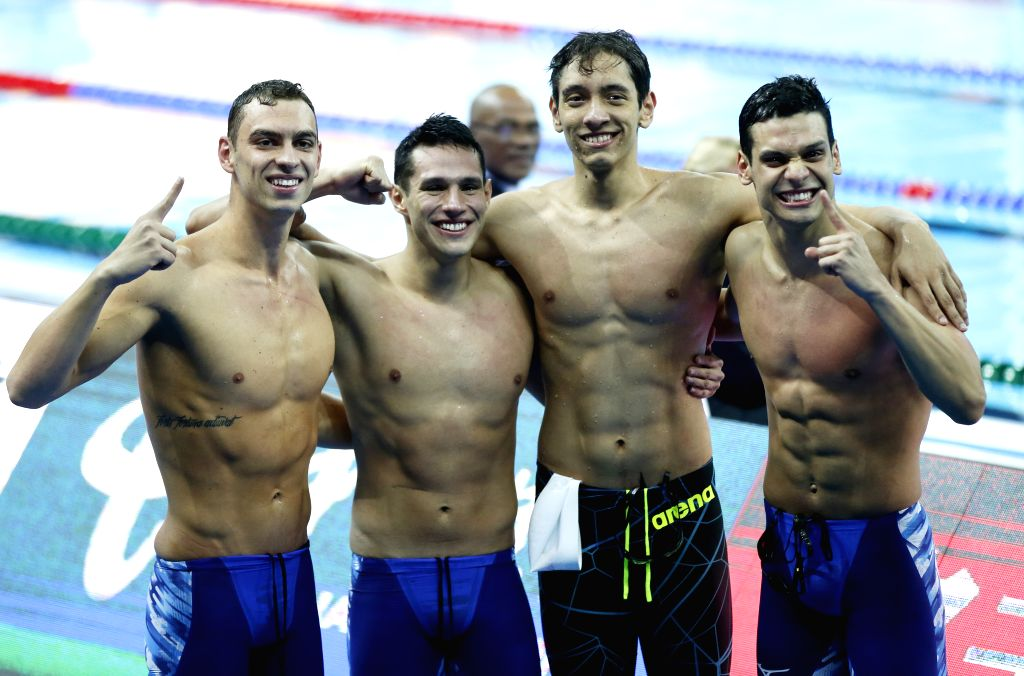 HANGZHOU, Dec. 14, 2018 - Leonardo Dos Santos, Luiz Altamir Melo, Breno Correia and Fernando Scheffer of Team Brazil celebrate after Men's Freestyle 4x200m Relay Final at 14th FINA World Swimming ...