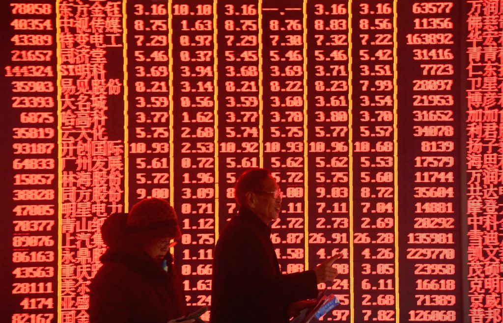 HANGZHOU, Feb. 11, 2019 - Investors are seen at a stock exchange in Hangzhou, east China's Zhejiang Province, Feb. 11, 2019, the first trading day of the Year of the Pig. China's major stock indices ...