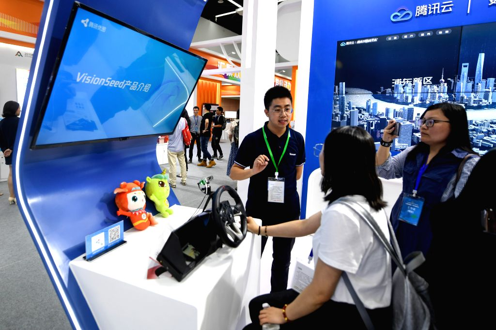 HANGZHOU, June 14, 2019 - A participant introduces an AI vision product to visitors during the national mass entrepreneurship and innovation week in Hangzhou, capital city of east China's Zhejiang ...