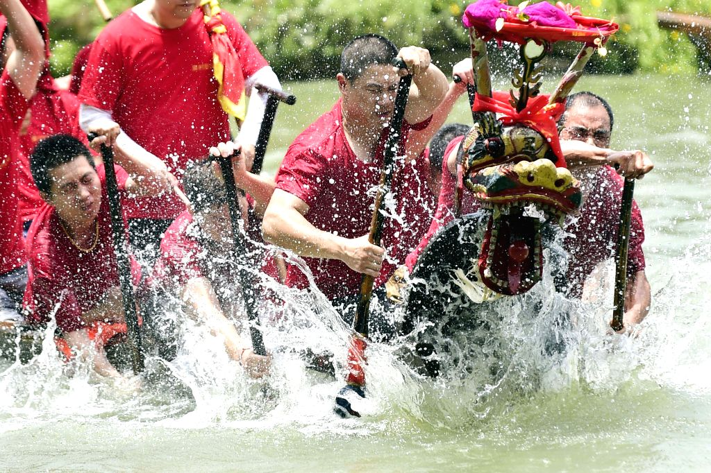 Participants compete in a dragon boat race to mark the Dragon Boat Festival, in Hangzhou, capital of east China's Zhejiang Province, June 20, 2015. The Dragon ...