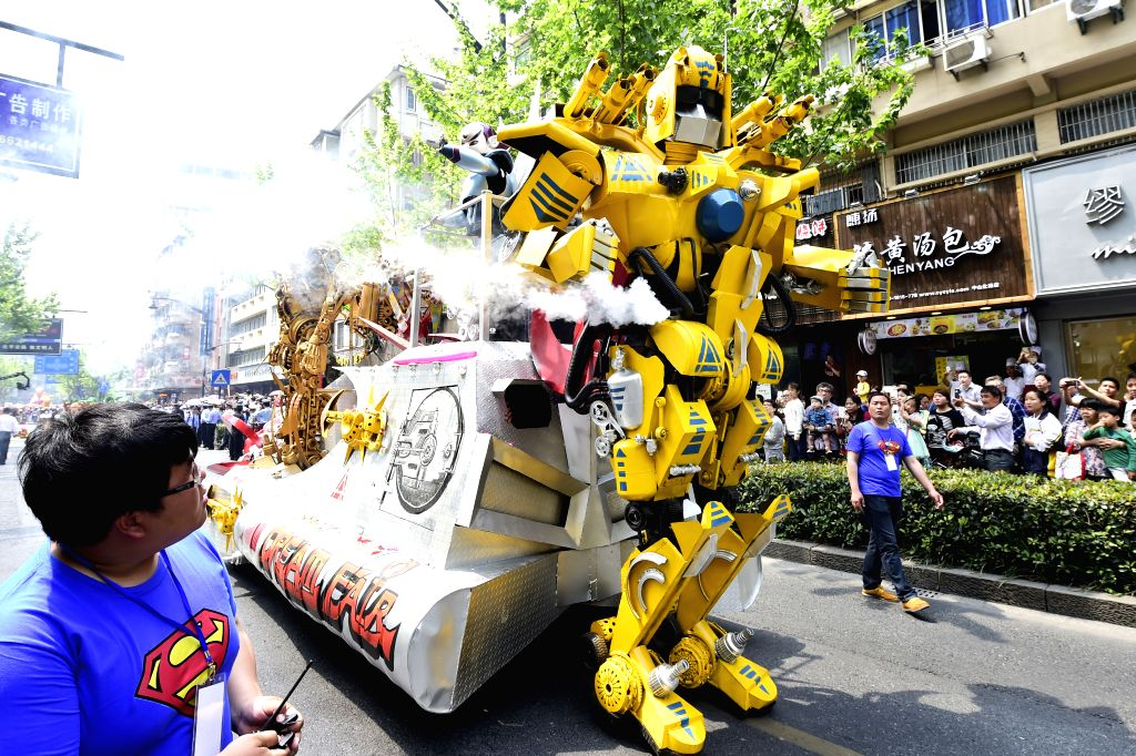A transformers float is seen in a parade during the 11th China International Cartoon & Animation Festival in Hangzhou, capital of east China's Zhejiang Province, ...
