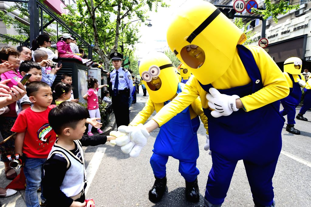 Performers in Minions costumes take part in a parade during the 11th China International Cartoon & Animation Festival in Hangzhou, capital of east China's ...