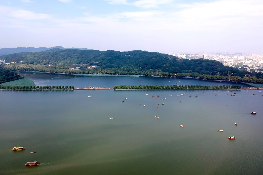 HANGZHOU, Oct. 9, 2017 - Photo taken on Oct. 1, 2017 shows boats in the West Lake scenic area in Hangzhou, capital of east China's Zhejiang Province. A total of 705 million tourists traveled around ...