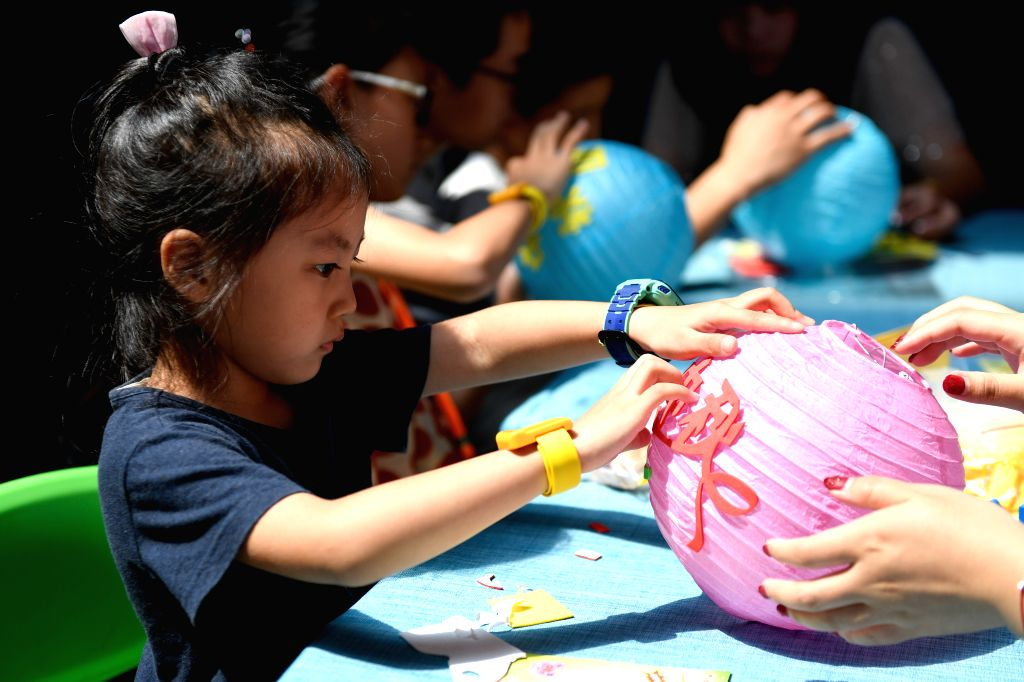 HANGZHOU, Sept. 13, 2019 - Children make lanterns at an activity to celebrate the Mid-Autumn Festival in Hangzhou, east China's Zhejiang Province, Sept. 13, 2019. Children took part in various ...