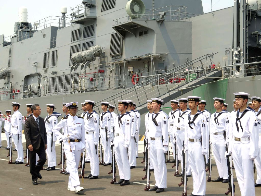 HANOI, April 12, 2016 - Japanese ambassador to Vietnam Hiroshi Fukada (1st L, front) inspects a guard of honor at the welcoming ceremony for officers and crew members of the two destroyers of Japan's ...