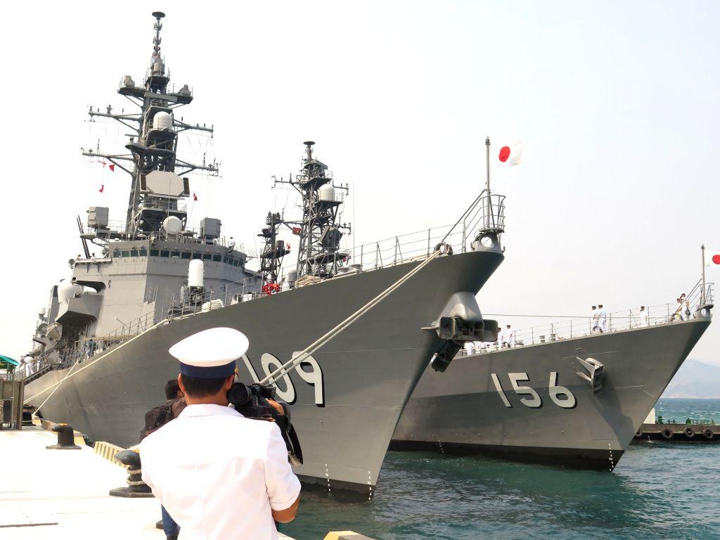 HANOI, April 12, 2016 - Two destroyers of Japan's Maritime Self-Defense Force, JS Ariake and JS Setogiri, dock at Cam Ranh International Seaport in Vietnam's central coastal province of Khanh Hoa, ...