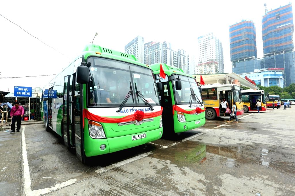 HANOI, Aug. 2, 2018 - Photo taken on Aug. 1, 2018 shows compressed natural gas-powered buses in Hanoi, Vietnam. Vietnam's capital Hanoi on Wednesday launched three routes of buses which use ...