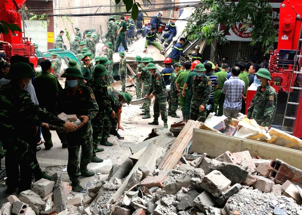 HANOI, Aug. 4, 2016 - Rescue workers work at the building collapse site in Hanoi, capital of Vietnam, Aug. 4, 2016. A four-storey building in Vietnam's capital Hanoi collapsed on Thursday morning ...