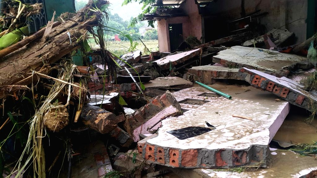 HANOI, Aug. 5, 2016 - Photo taken on Aug. 5, 2016 shows collapsed houses in Lao Cai province, north Vietnam. Floods triggered by heavy rain due to Typhoon Nida have left three dead while seven others ...