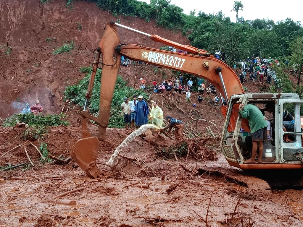 HANOI, Aug. 9, 2019 - Rescuers search for missing people at a landslide site in Dak Nong province, Vietnam, on Aug. 8, 2019. As of Friday afternoon, floods and landslides in Vietnam's central ...