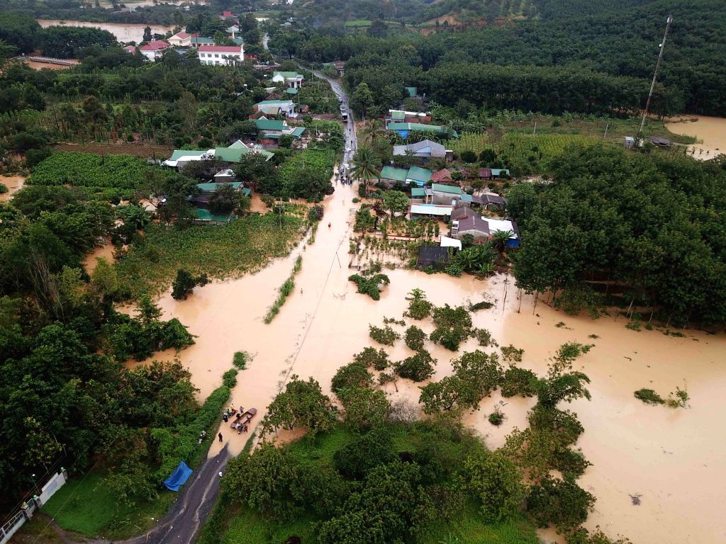 HANOI, Aug. 9, 2019 - The photo taken on Aug. 8, 2019 shows floods triggered by heavy rains inundating roads and residential areas in Lam Dong province, Vietnam. As of Friday afternoon, floods and ...