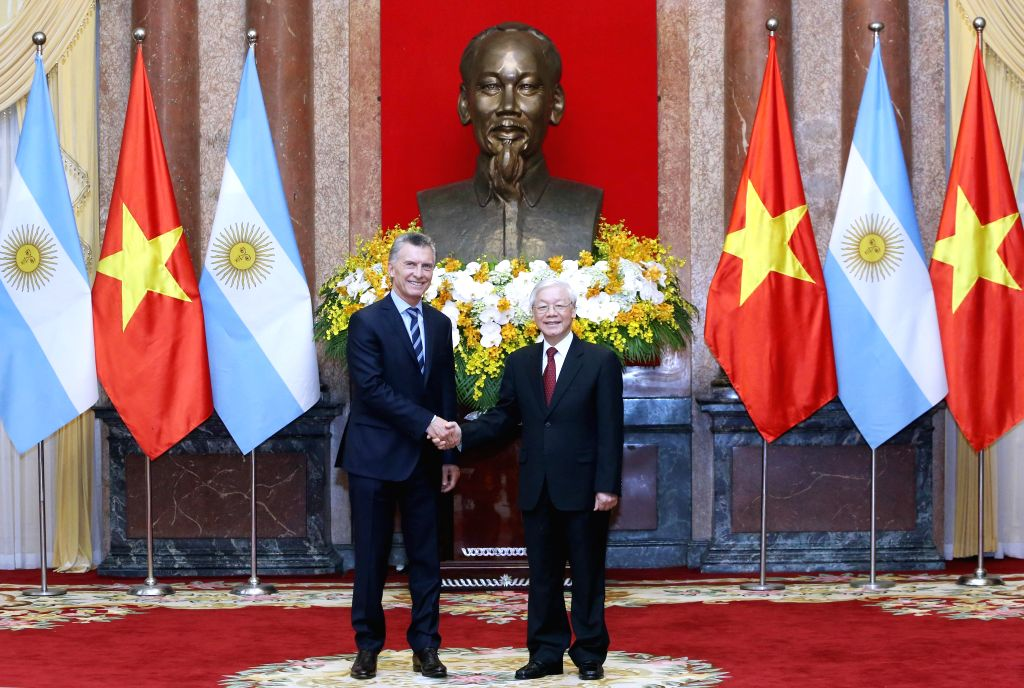 HANOI, Feb. 20, 2019 - Vietnamese President Nguyen Phu Trong (R), who is also general secretary of the Communist Party of Vietnam Central Committee, shakes hands with Argentine President Mauricio ...