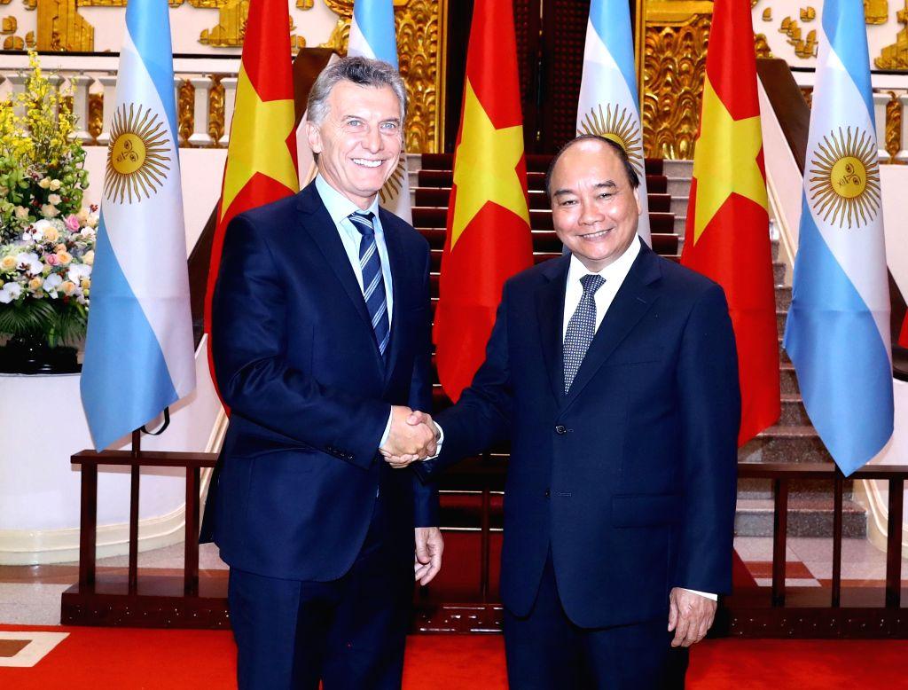 HANOI, Feb. 20, 2019 - Vietnamese Prime Minister Nguyen Xuan Phuc (R) meets with Argentine President Mauricio Macri in Hanoi, capital of Vietnam, Feb. 20, 2019. Mauricio Macri is on a state visit to ... - Nguyen Xuan Phuc