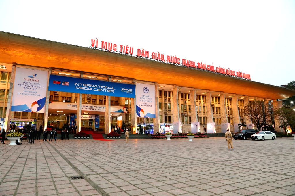 HANOI, Feb. 24, 2019 - People pass by the International Media Center for the second summit between the Democratic People's Republic of Korea (DPRK) and the United States in Hanoi, Vietnam, on Feb. ...