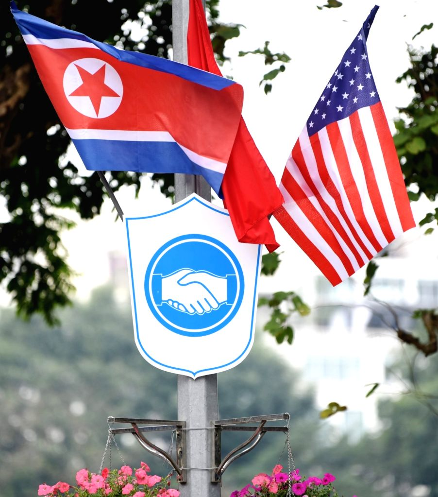 HANOI, Feb. 25, 2019 - Photo taken on Feb. 25, 2019 shows national flags of Vietnam, the DPRK and the United States in Hanoi, Vietnam. The second summit between top leader of the Democratic People's ...