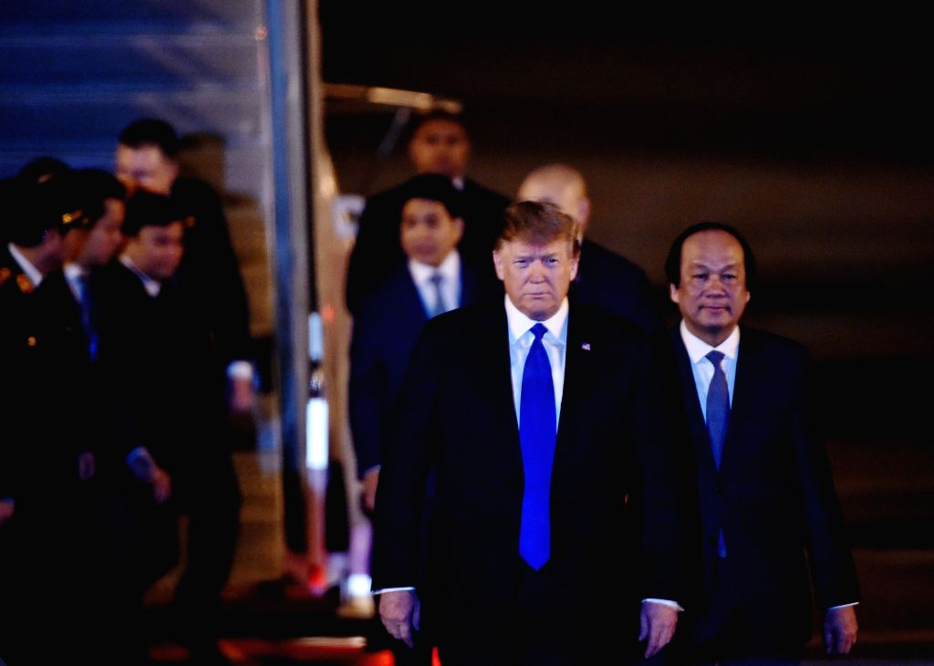 HANOI, Feb. 26, 2019 (Xinhua) -- U.S. President Donald Trump (front) arrives at an airport in Hanoi, Vietnam, Feb. 26, 2019. U.S. President Donald Trump arrived in Vietnam's capital Hanoi on Tuesday night to meet with Kim Jong Un, top leader of the D