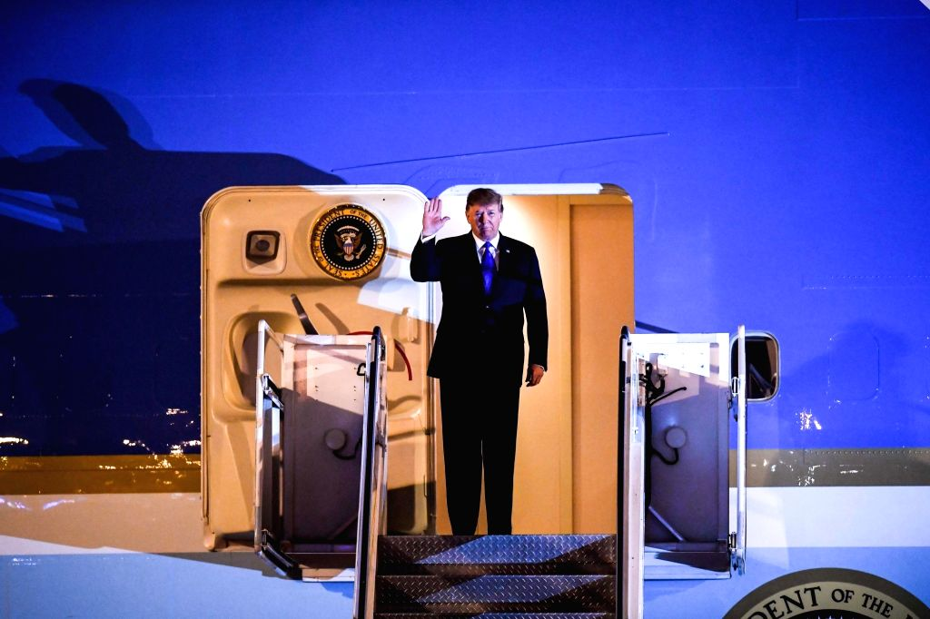 Hanoi: In this AFP photo, U.S. President Donald Trump waves from Air Force One as he arrives in Hanoi on Feb. 26, 2019, for a two-day summit with North Korean leader Kim Jong-un on Pyongyang's denuclearization.(Yonhap/IANS)