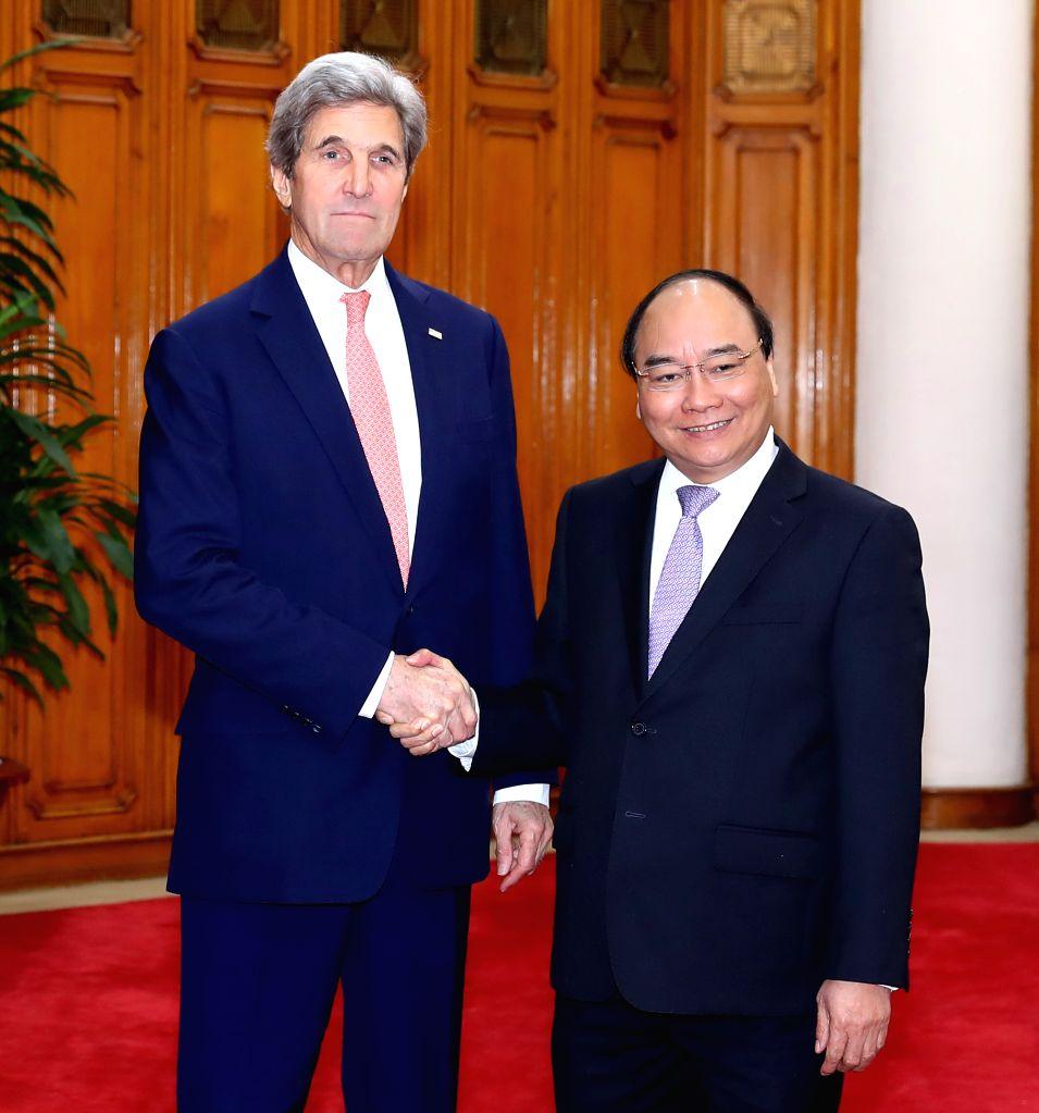 HANOI, Jan. 13, 2017 - Vietnamese Prime Minister Nguyen Xuan Phuc (R) shakes hands with visiting U.S. Secretary of State John Kerry in Hanoi, capital of Vietnam, Jan. 13, 2017. Kerry is visiting ... - Nguyen Xuan Phuc