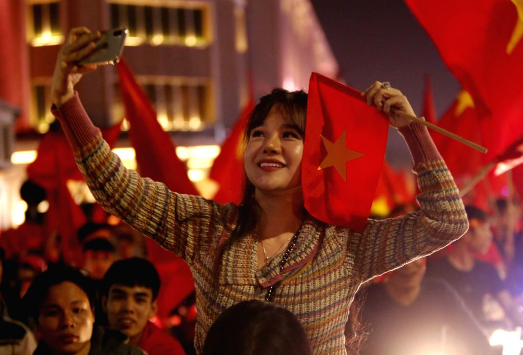 HANOI, Jan. 24, 2018 - Vietnamese people celebrate their U23 national soccer team's victory of the AFC U23 Football Championship semifinal match against Qatar, in Hanoi, Vietnam, Jan. 23, 2018. ...