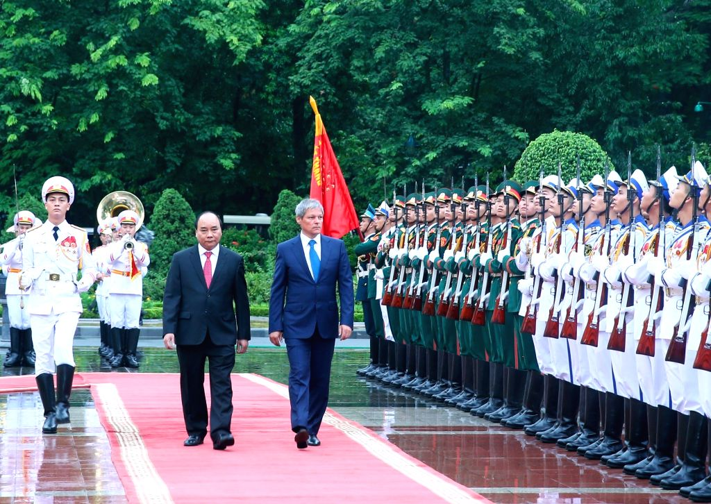 HANOI, July 12, 2016 - Vietnamese Prime Minister Nguyen Xuan Phuc (L, front) and his visiting Romanian counterpart Dacian Ciolos review a guard of honor in Hanoi, capital of Vietnam, July 12, 2016. ... - Nguyen Xuan Phuc