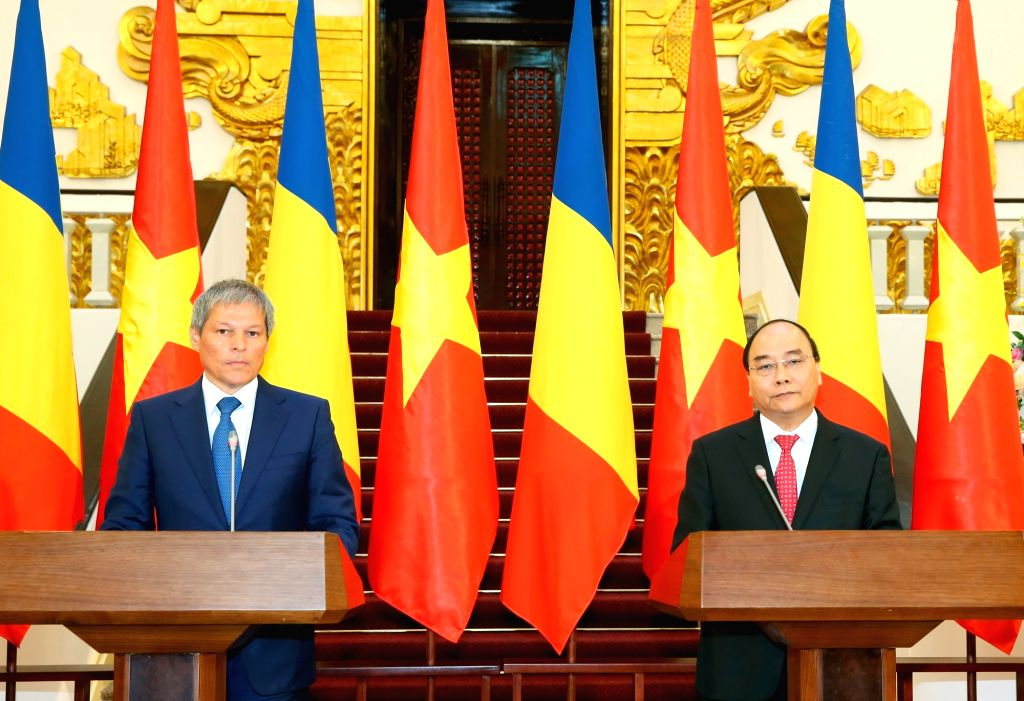 HANOI, July 12, 2016 - Vietnamese Prime Minister Nguyen Xuan Phuc (R) and his visiting Romanian counterpart Dacian Ciolos hold a press conference after their meeting in Hanoi, capital of Vietnam, ... - Nguyen Xuan Phuc