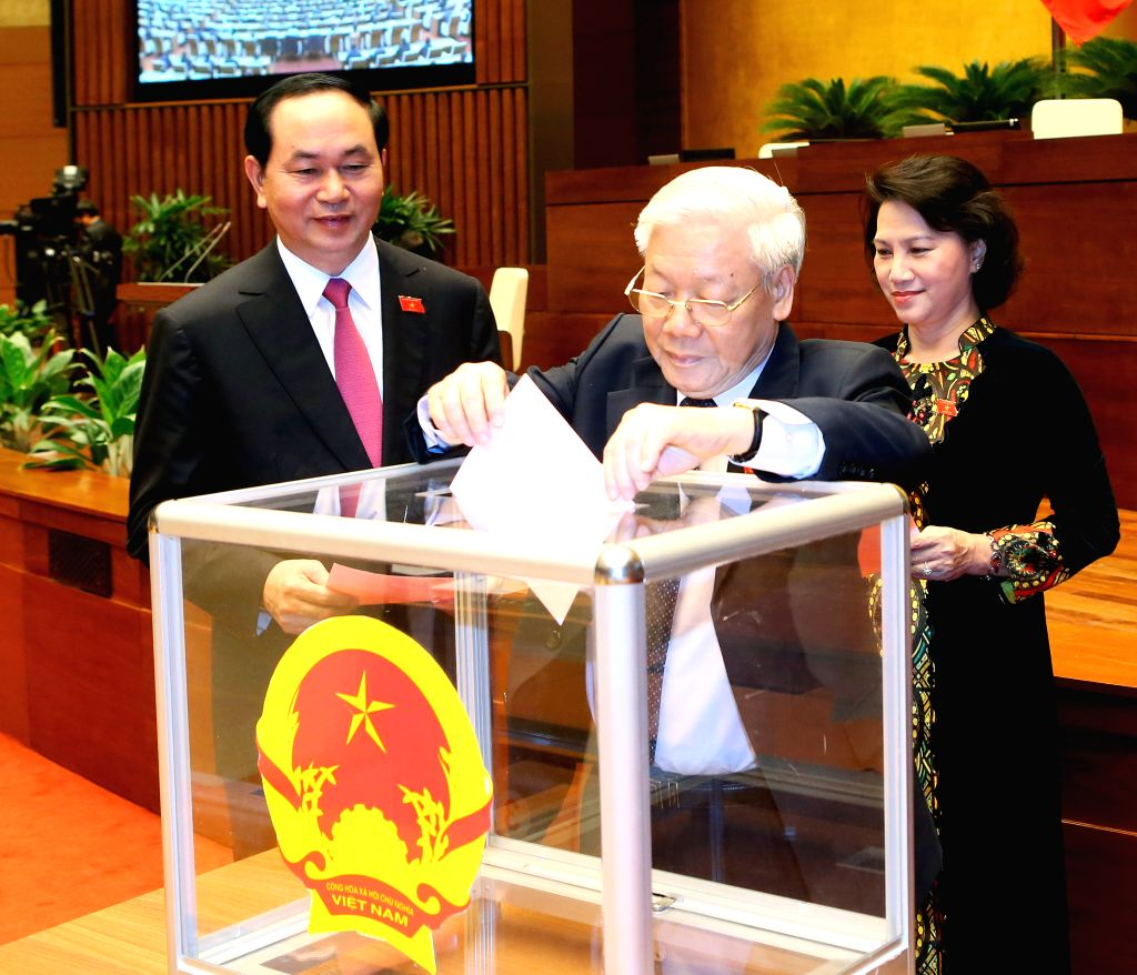 HANOI, July 25, 2016 - General Secretary of the Communist Party of Vietnam Central Committee Nguyen Phu Trong (C) votes for the position of President of Vietnam, in Hanoi, capital of Vietnam, July ...