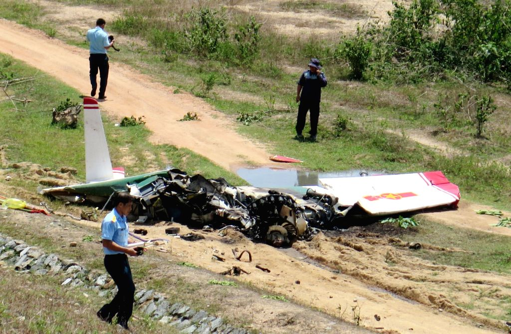 HANOI, June 14, 2019 - Photo taken on June 14, 2019 shows the site of military plane crash in Vietnam's central Khanh Hoa province. A military plane crashed in Vietnam's central Khanh Hoa province ...