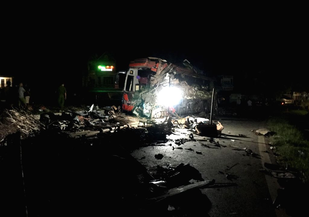 HANOI, June 17, 2019 - Photo taken on June 17, 2019 shows the site of a traffic accident in Hoa Binh province, Vietnam. A steel-carrying truck hit a 40-seater coach in Vietnam's northern Hoa Binh ...