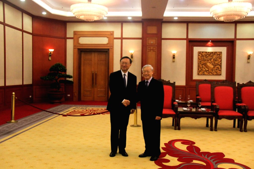 HANOI, June 27, 2016 - General Secretary of the Communist Party of Vietnam Central Committee Nguyen Phu Trong (R) shakes hands with visiting Chinese State Councilor Yang Jiechi in Hanoi, capital of ...