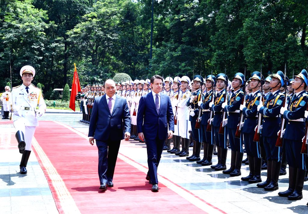 HANOI, June 5, 2019 - Vietnamese Prime Minister Nguyen Xuan Phuc (L) and visiting Italian Prime Minister Giuseppe Conte review guards of honor during a welcome ceremony in Hanoi, capital of Vietnam, ... - Nguyen Xuan Phuc