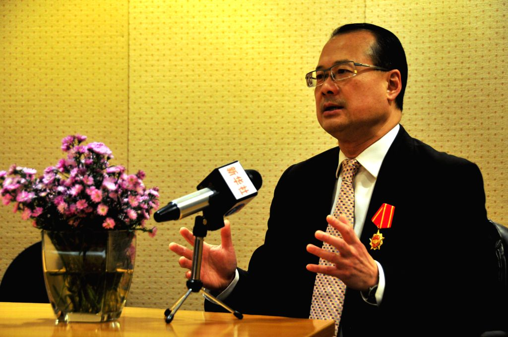 Jonathan Choi Koon-shum, the Sunwah Group chairman and the permanent honorary president of the Chinese General Chamber of Commerce of Hong Kong, receives an ...