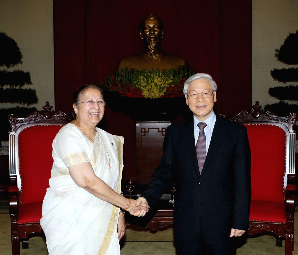 Nguyen Phu Trong (R), general secretary of the Communist Party of Vietnam, shakes hands with Sumitra Mahajan, speaker of the Lok Sabha, the lower house of India's ... - Sumitra Mahajan