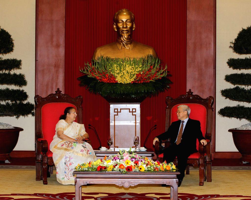 Nguyen Phu Trong (R), general secretary of the Communist Party of Vietnam, meets with Sumitra Mahajan, speaker of the Lok Sabha, the lower house of India's ... - Sumitra Mahajan