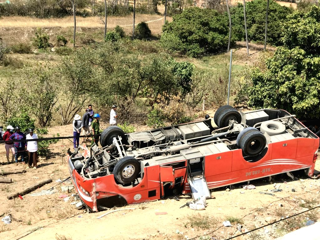 HANOI, March 9, 2019 - Photo taken on March 9, 2019 shows the turned-over coach at the site of a traffic accident in central Binh Thuan province, Vietnam. A 30-seat coach suddenly ran off course to ...
