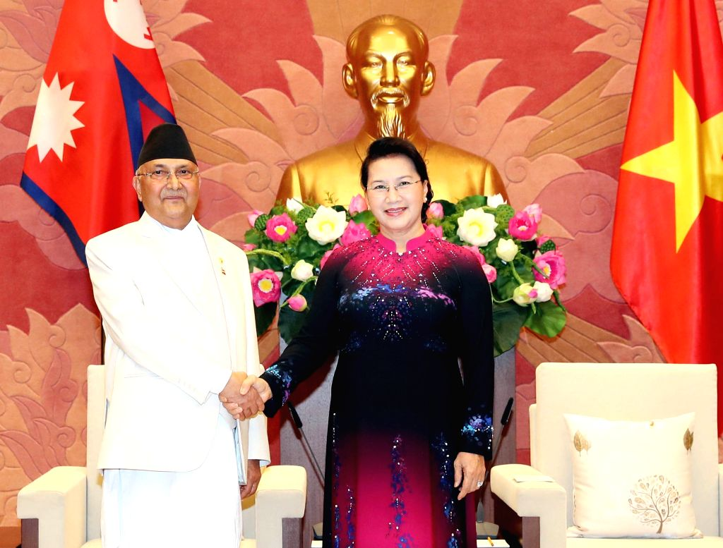 HANOI, May 11, 2019 - Chairwoman of the Vietnamese National Assembly Nguyen Thi Kim Ngan (R) shakes hands with visiting Nepali Prime Minister K.P. Sharma Oli in Hanoi, capital of Vietnam, May 11, ... - K. and P. Sharma Oli