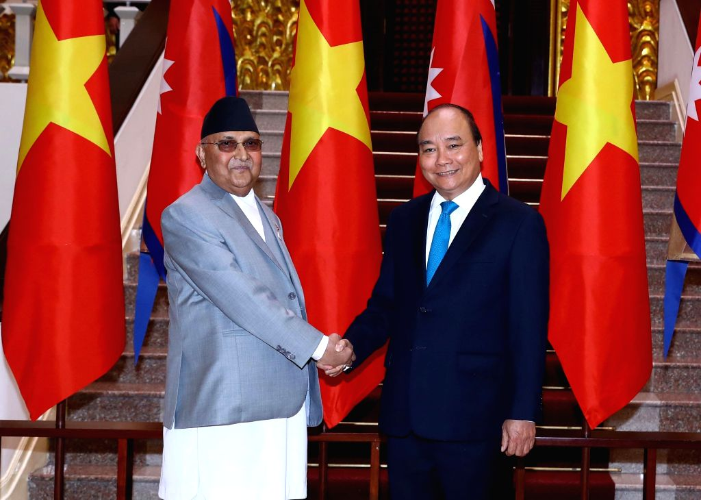 HANOI, May 11, 2019 - Vietnamese Prime Minister Nguyen Xuan Phuc (R) shakes hands with his visiting Nepali counterpart K.P. Sharma Oli in Hanoi, capital of Vietnam, May 11, 2019. The prime ministers ... - Nguyen Xuan Phuc and P. Sharma Oli