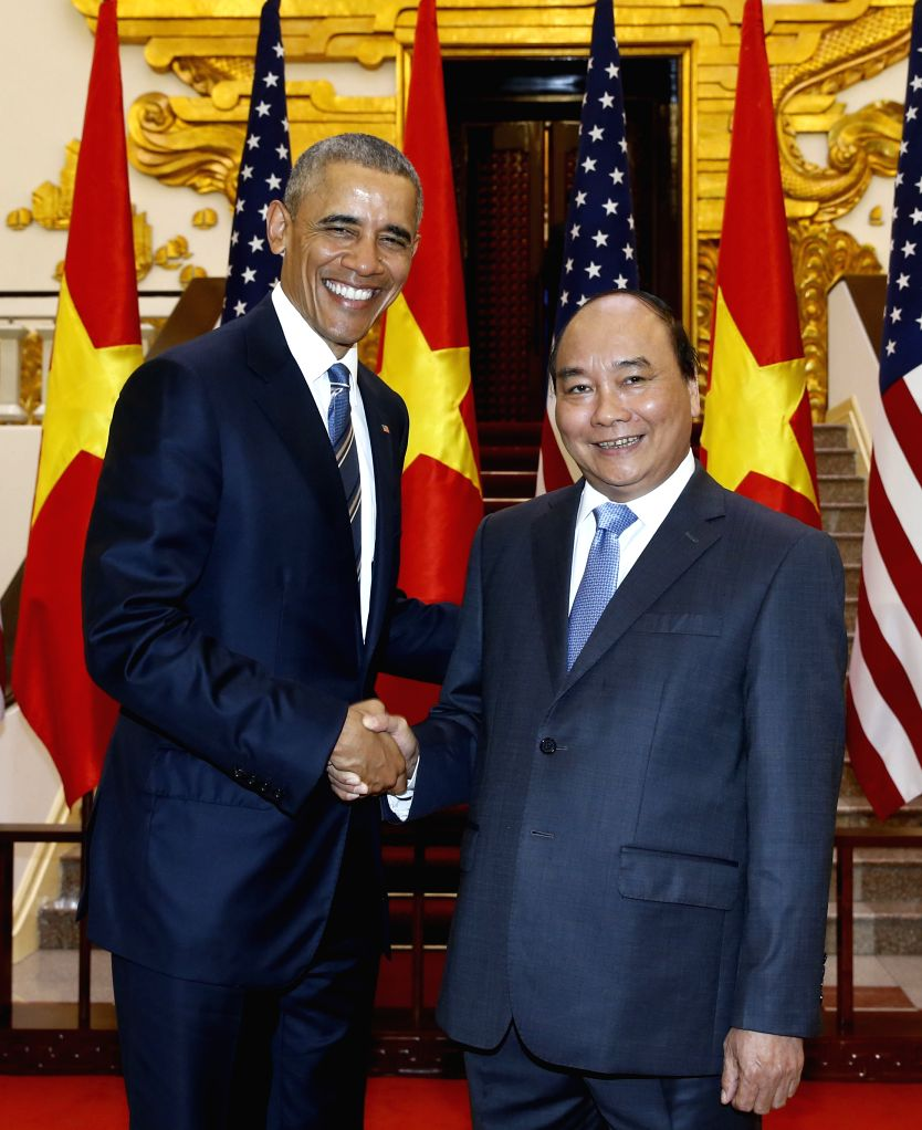 HANOI, May 23, 2016 - Vietnamese Prime Minister Nguyen Xuan Phuc (R) shakes hands with U.S. President Barack Obama in Hanoi, capital of Vietnam, May 23, 2016. Obama arrived at Noi Bai international ... - Nguyen Xuan Phuc